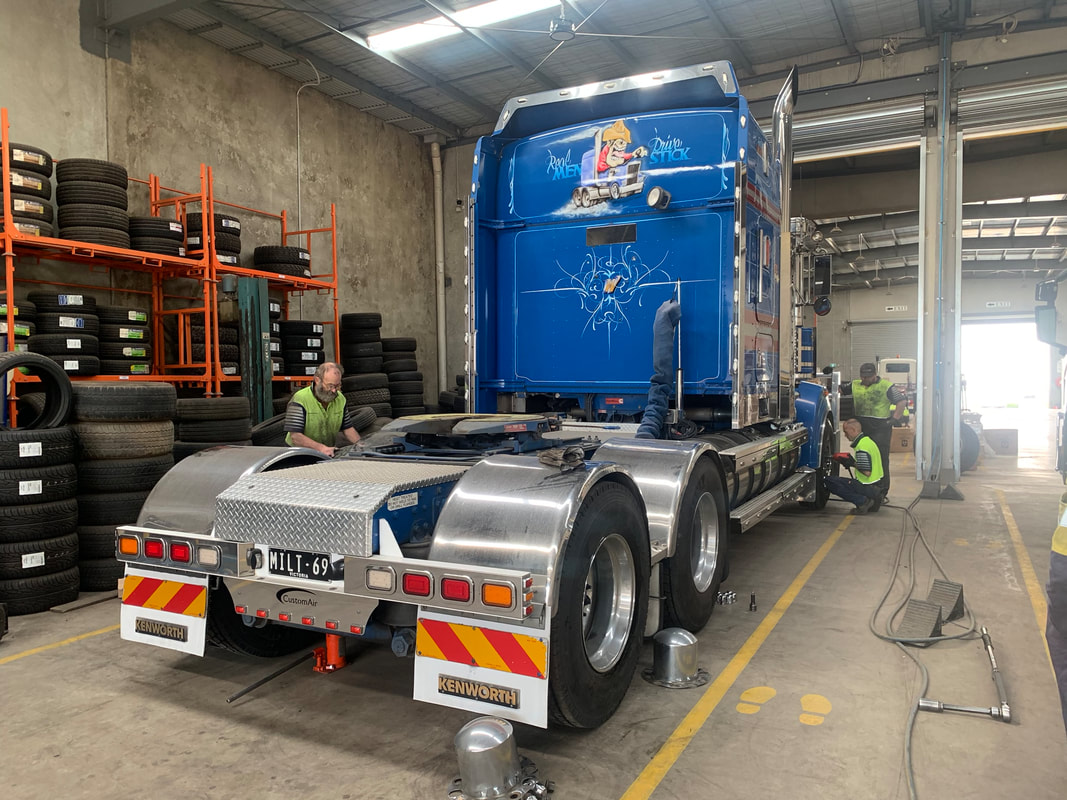 Routine Truck Tyre Maintenance Being Carried Out